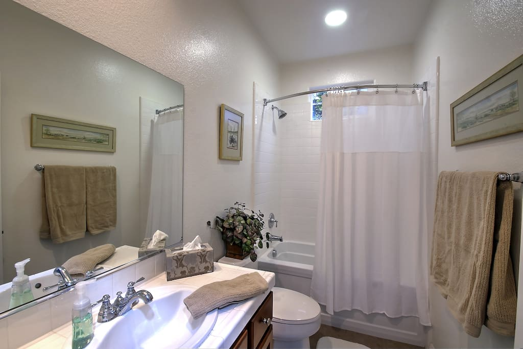 Private bathroom with full bath, shower and measures around 5' x 9.5'.