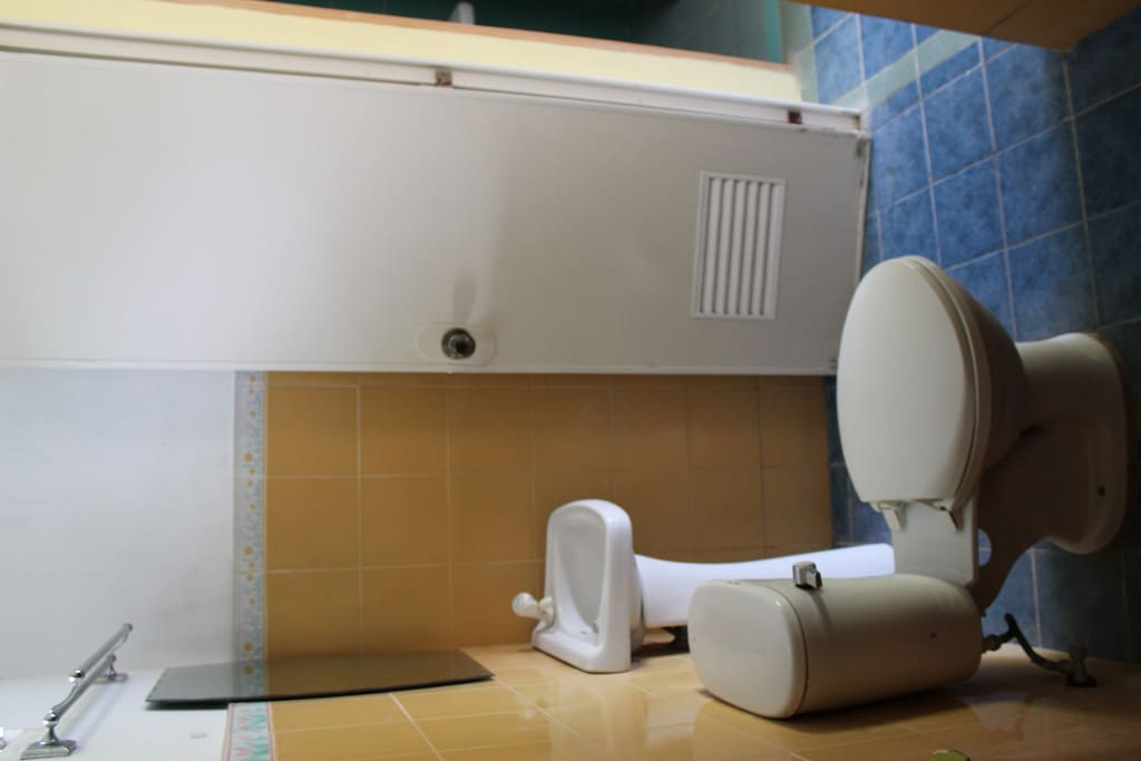 This is a shared comfort room with hot and cold shower.