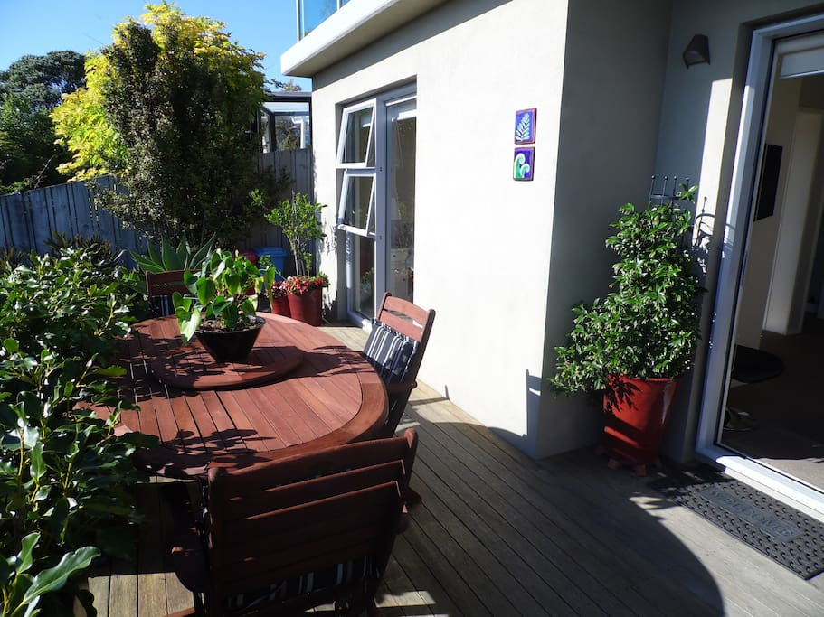 Kawau Apartment Deck and Master Bedroom windows/door (left) and Main entrance (right)