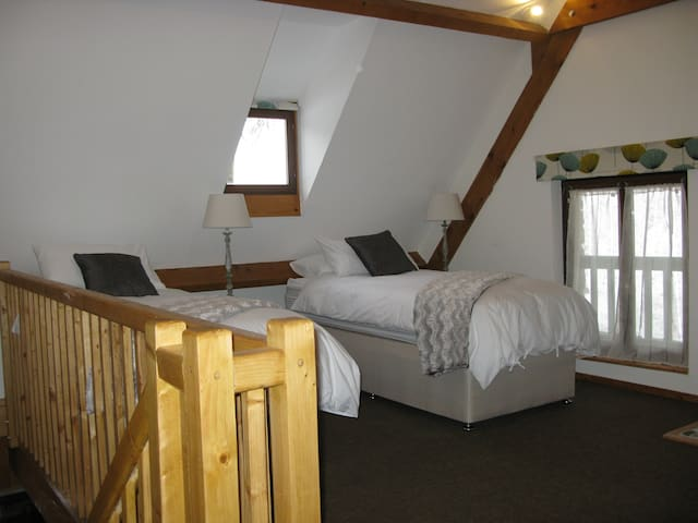 The spacious bedroom can be configured with a kingsize or two single beds