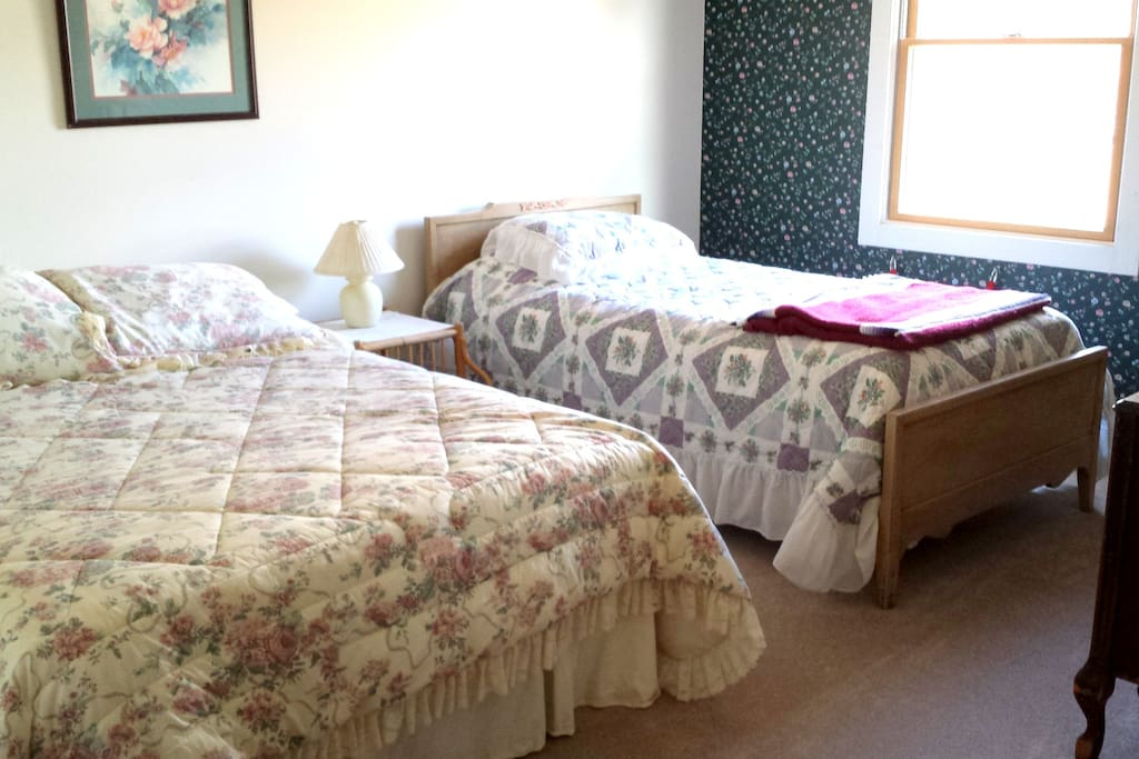 This is the upstairs Middle Room, and has a Queen Bed and a Twin Bed with private full bath.