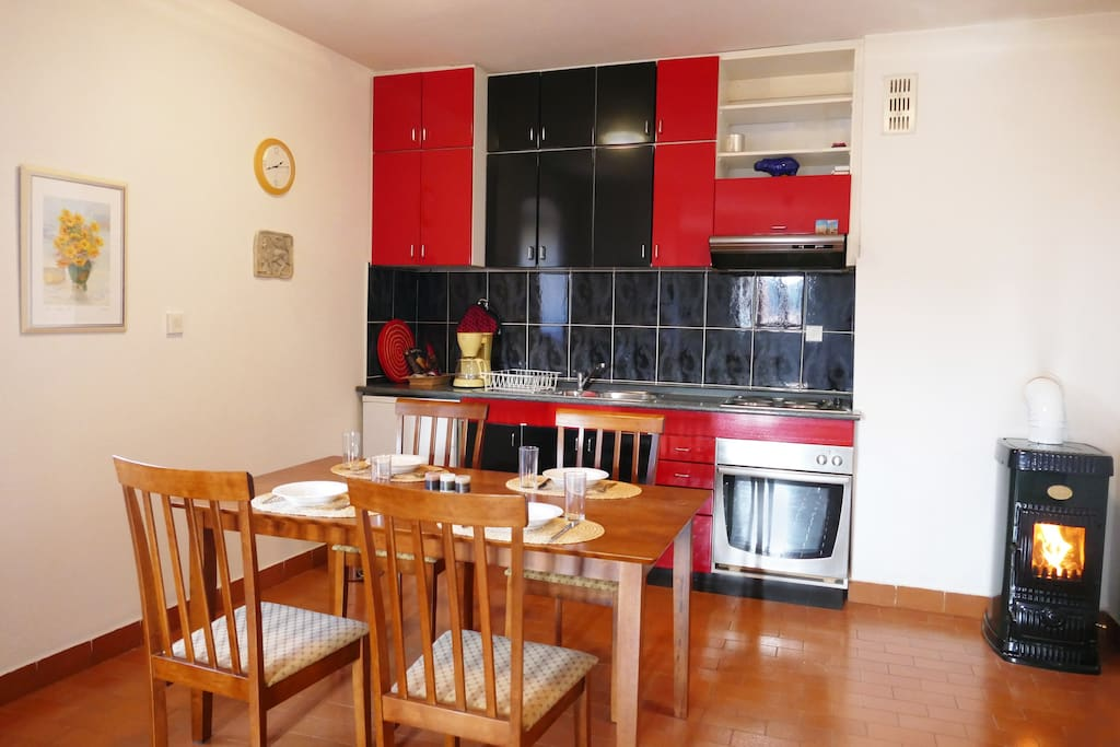 The fully equipped, spacious kitchen with fridge, cooking stove (4 plates) , water cooker and fireplace.