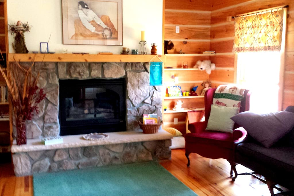 The shared Living Room with gas fireplace