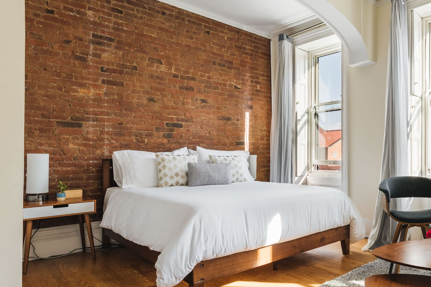 Master bedroom with exposed brickwork