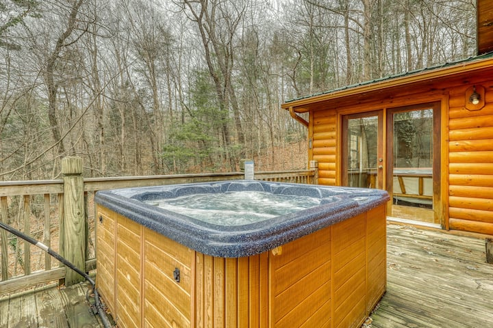 Lakefront getaway w/ a furnished deck, private hot tub, & lakeside fire pit