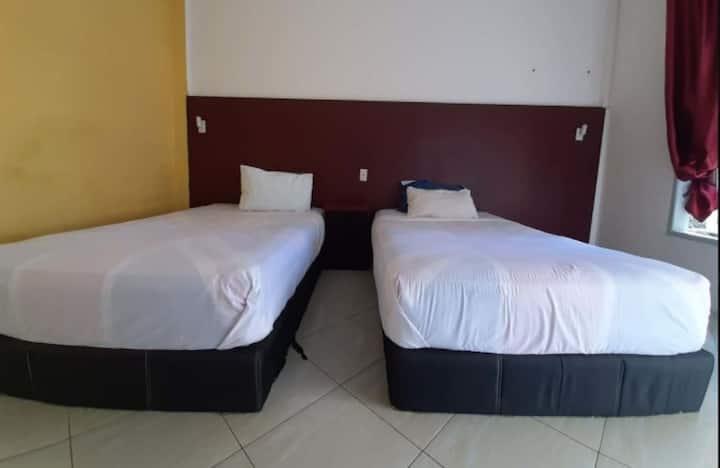 Clean Deluxe Room at Juma Eluk Hostelry