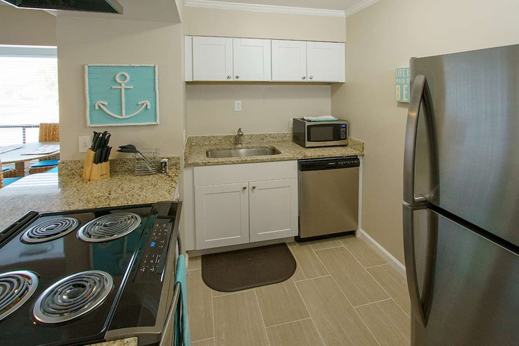 Brand new stainless steel appliances and granite counter tops