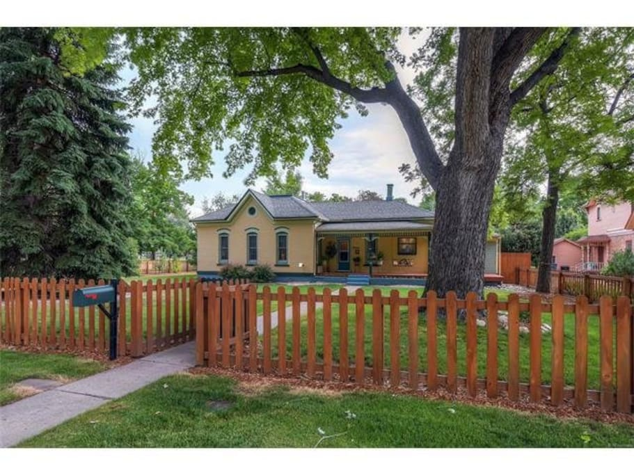 Picket fence in front yard and front gate