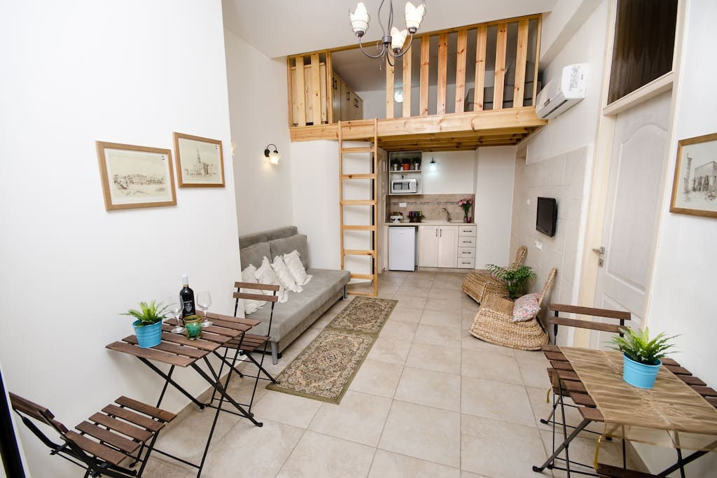 Spirit of Tzfat Yamma guesthouse. Salon area with dining corner, kosher kitchen, loft.