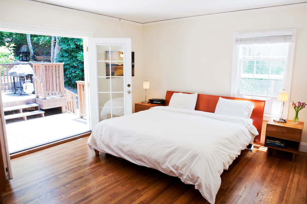 Master bedroom with french doors opens to backyard and deck.