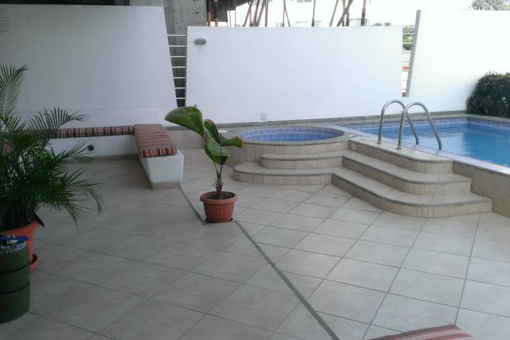 2nd floor pool area with Jacuzzi.