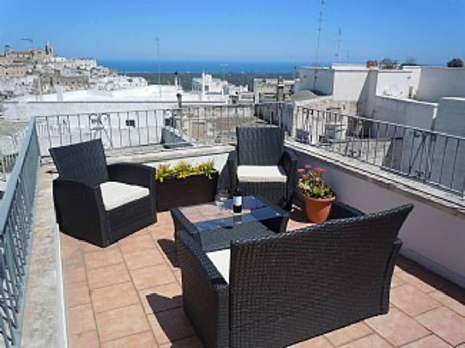 Upper terrace with views of sea and city.  3rd floor