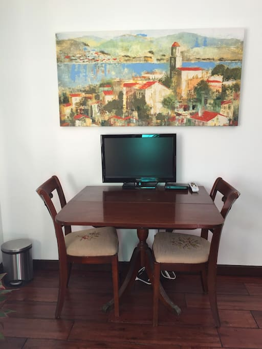 Table for eating or working privately. The room also has wireless internet and DirecTV with many movie channels.