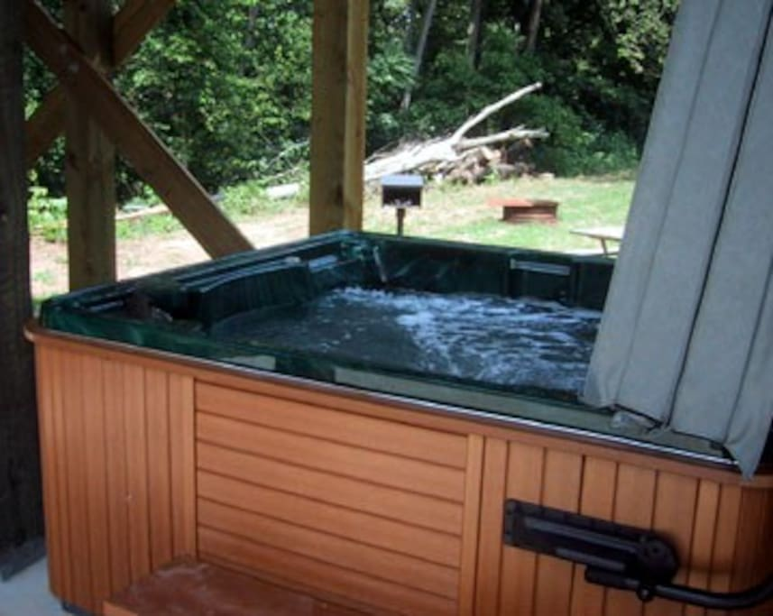 6 person hot tub with colored lights and waterfall