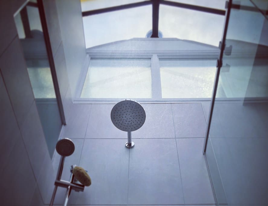 Enjoy a relaxing warm shower under the skylight