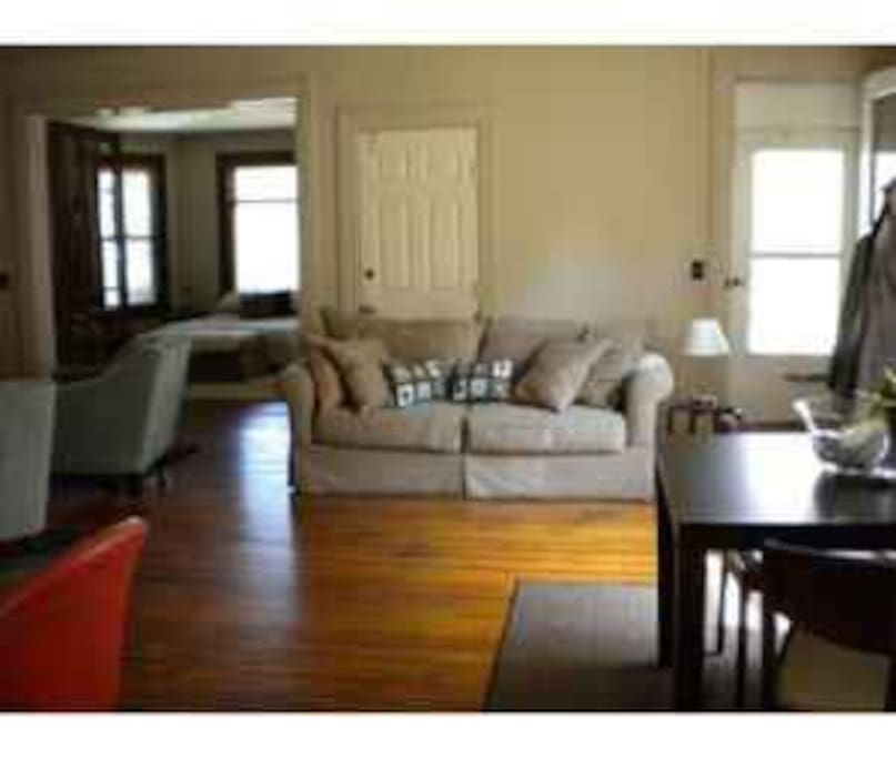 Sunny living area with gleaming hardwoods throughout; place is entire 1st floor of turn-of-century home!