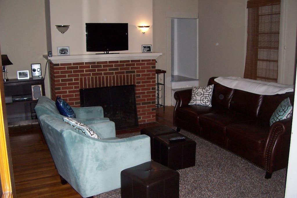 Comfortable living room to relax or entertain on high end furnishings and original brick fireplace. Barware too.