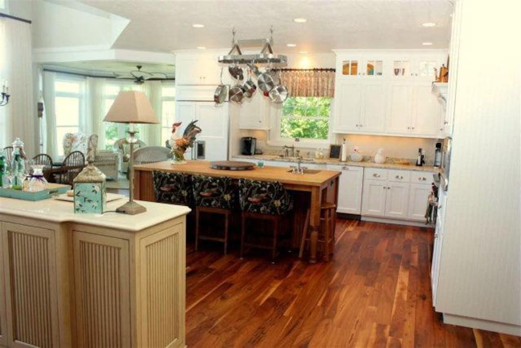 Fully appointed kitchen with high end appliances and beautiful bar and island