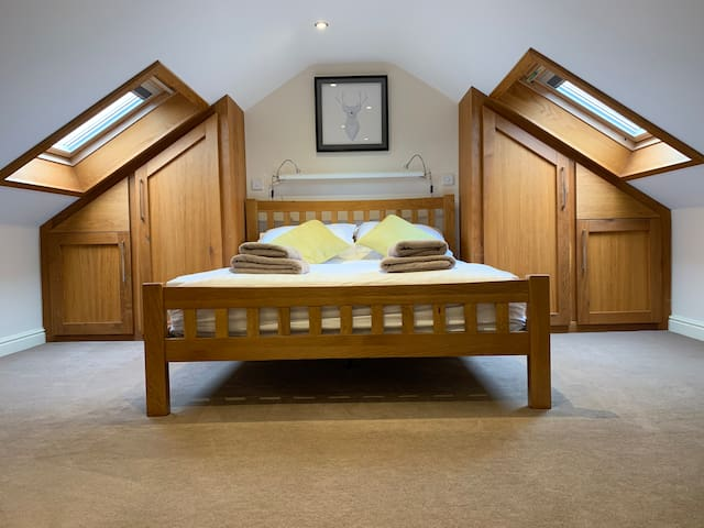 Upstairs galleries bedroom with king size bed.