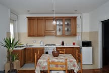 Kitchen with gas stove, electric oven, microwave, small fridge, new Nespresso coffee machine, kettle and toaster. Fully equipped with utensils, china, and pots and pans for 4.