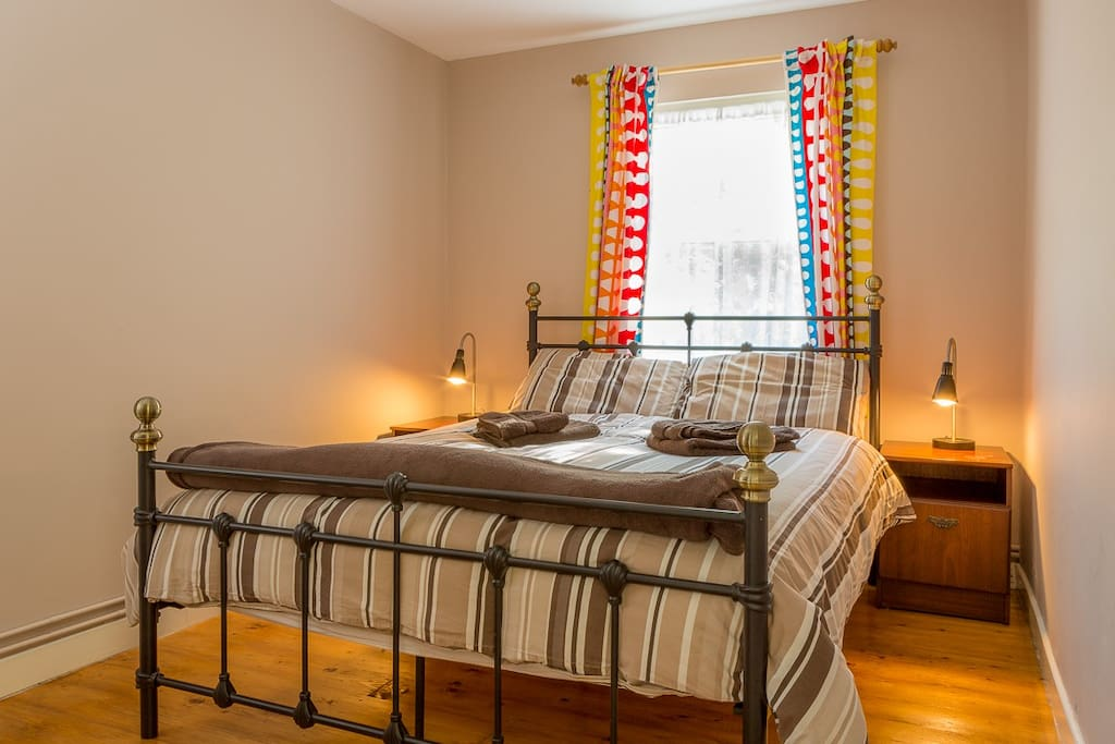 There is one double and one twin bedroom with comfy traditional-style wrought-iron beds and plenty of wardrobe space. A cot is also provided for our younger guests
