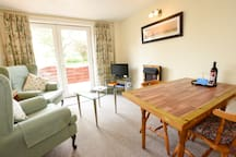 Lounge and diner in one room, meaning you can enjoy the countryside view from where ever you're sitting within the cottage.