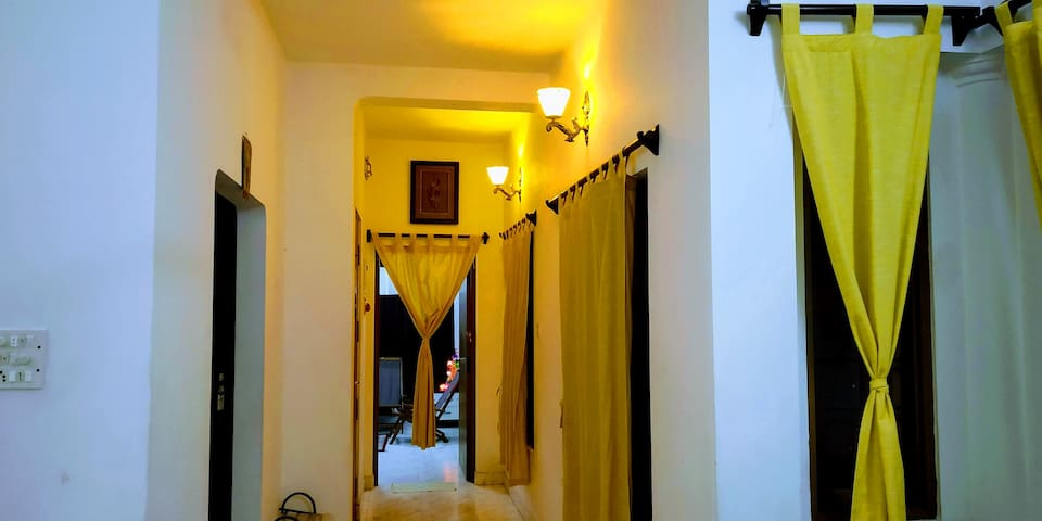 Passage to the master bedroom, kitchen