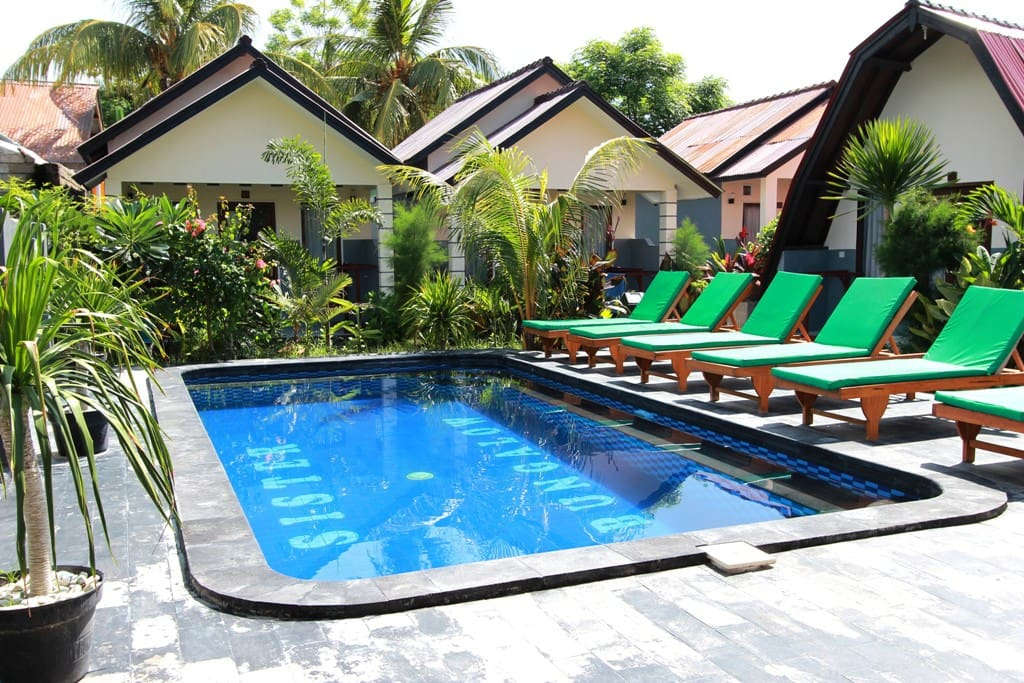 Swimming pool with sunbed