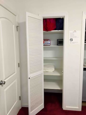 Extra closet to put all your clothes and shoes