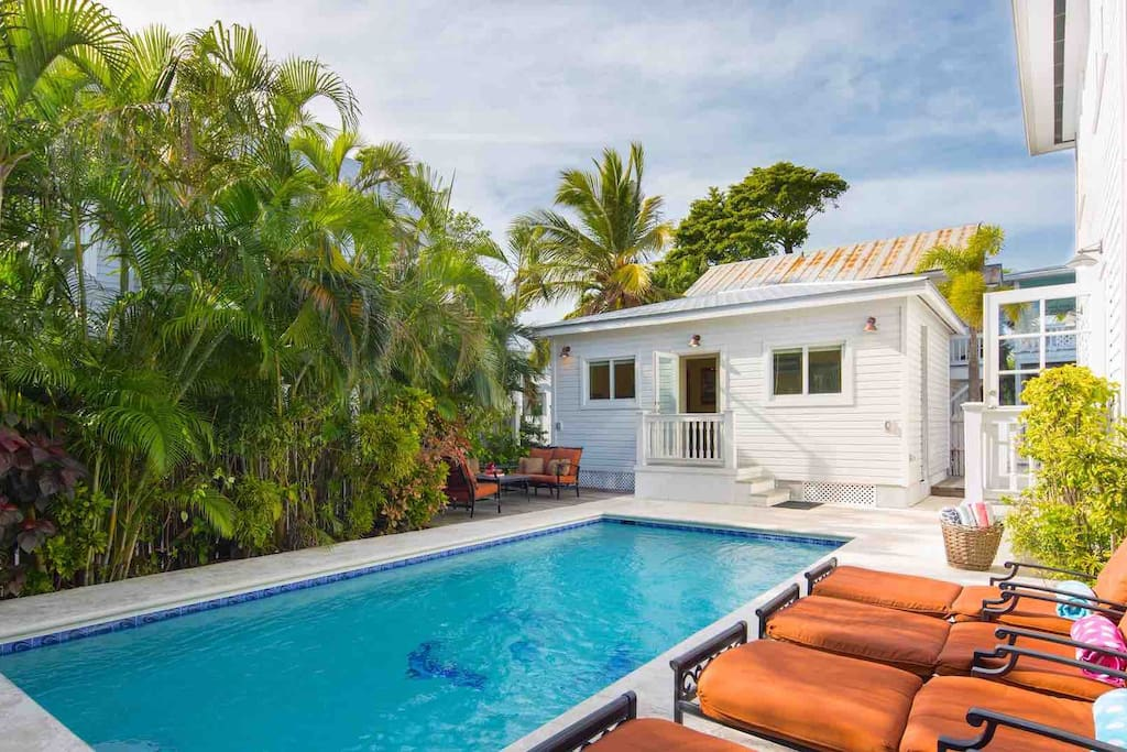 The heat optional pool is completely private and surrounded by lush landscaping...