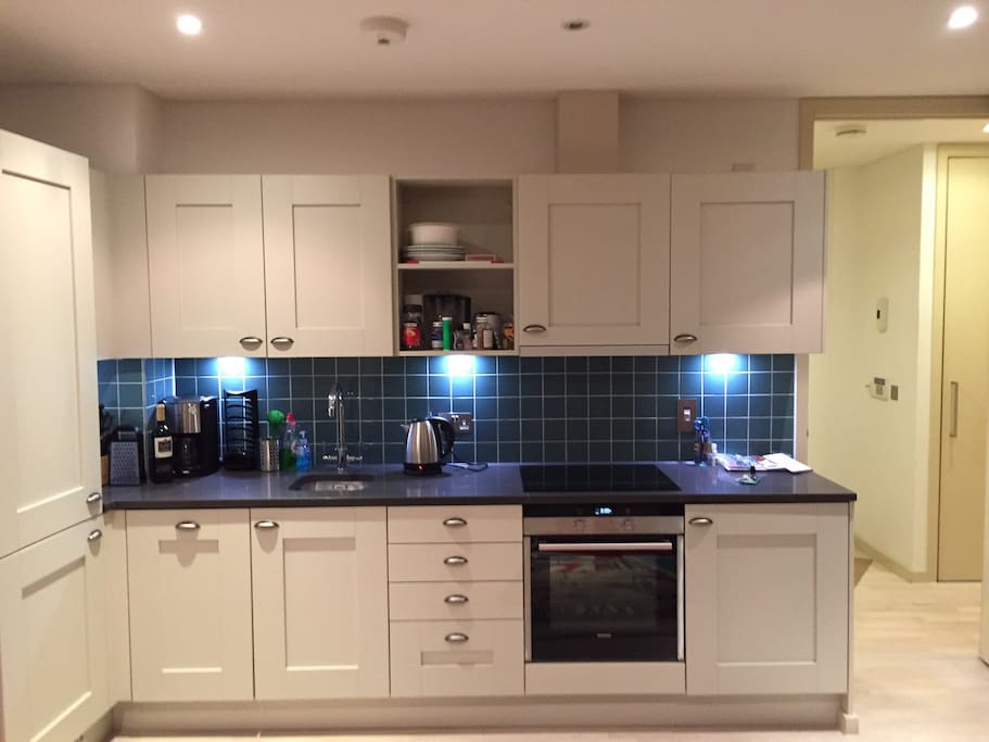 modern kitchen with integrated dishwasher and washer dryer