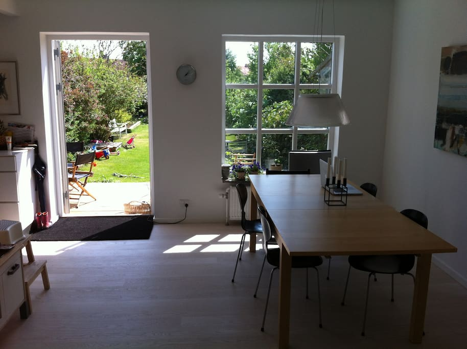 Dining room opening onto the sun terrace and garden