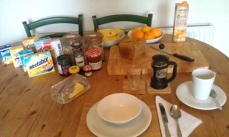 Breakfast; fresh bread & jam, tea & coffee, juice, cereal & fruit. Example of food served here. Exact breakfast may change. Subject to availability.
