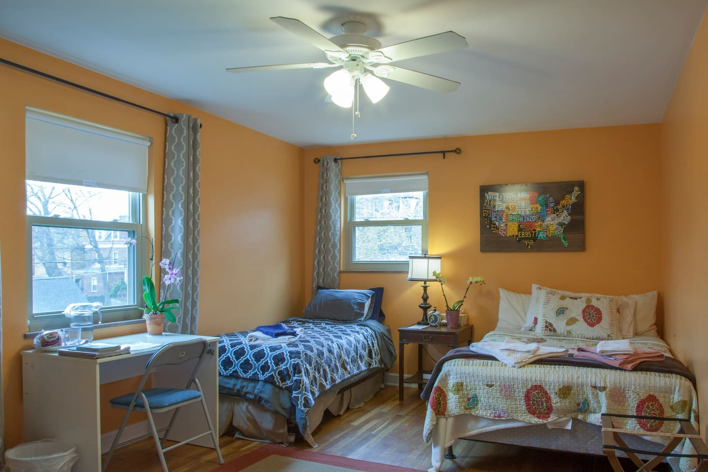 Very spacious bedroom full of natural light. Includes a twin bed, full size bed, Study desk, and couch. (see next picture)