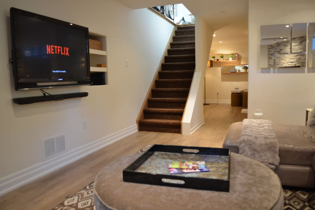 Stairs down to lower level, large screen TV, wide range of cable channels and Netflix equipped