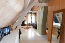 The attic has a light and bright feel with its high roof.