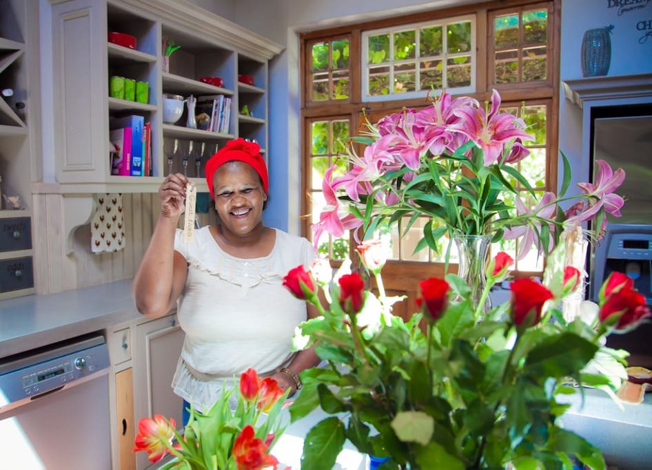 Mabel is our Housekeeper for the last 11 years, standing in our main house kitchen in this picture