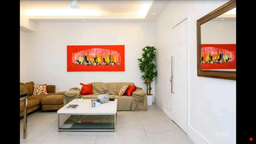 Living room,ceiling fan,flat located just one block from the beach Copacabana othon hotel area beach