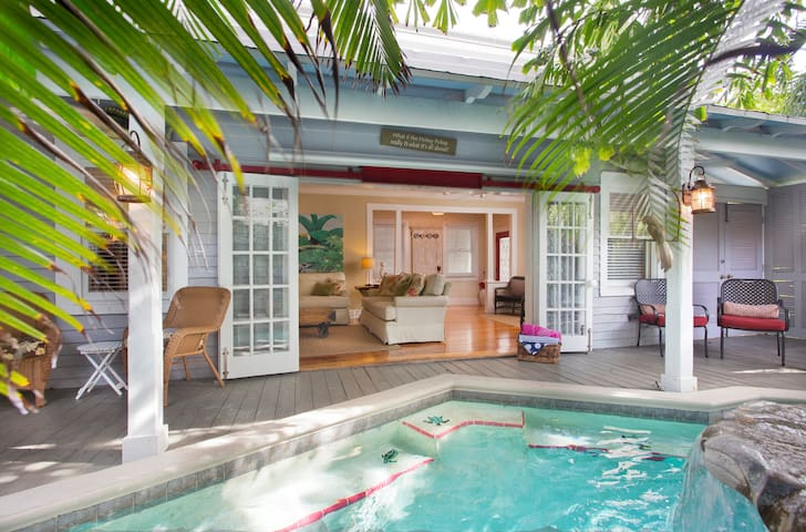 Private pool area leads directly to living room through traditional French doors