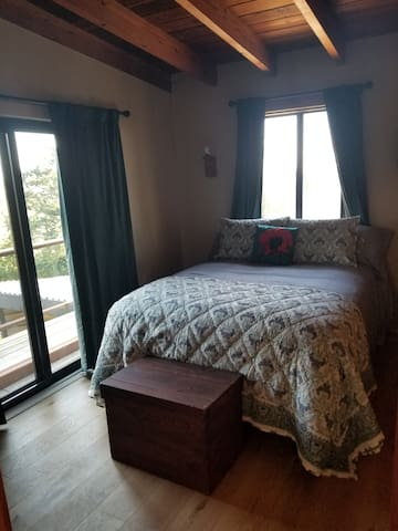 Queen bedroom with deck
