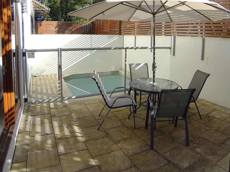 Private plunge pool and outdoor patio/dining area.