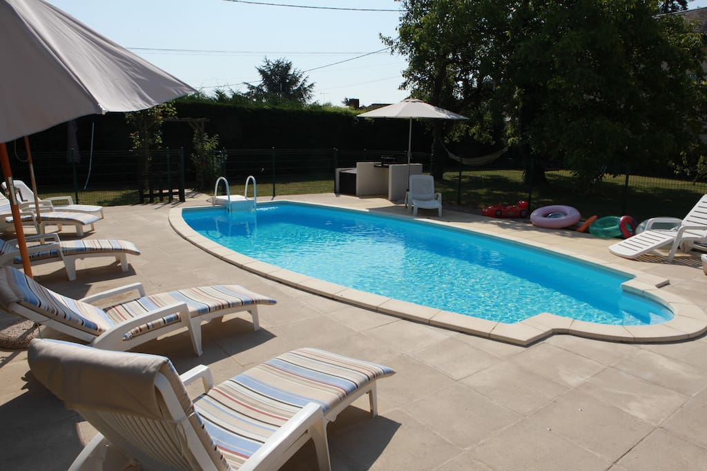 View of pool and BBQ area