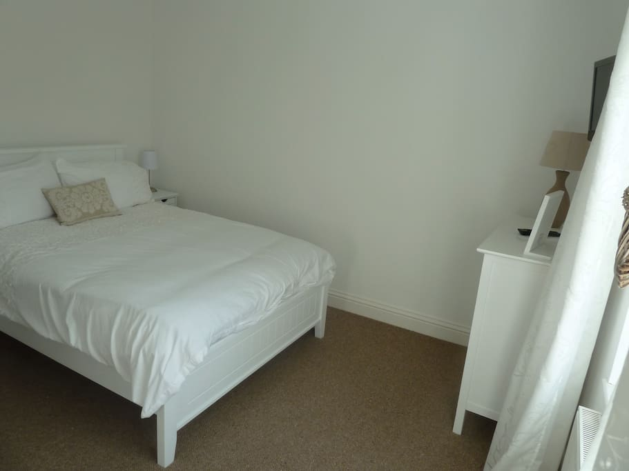 Main double bedroom has safe and t.v. Ironing board and iron, inside wardrobe.