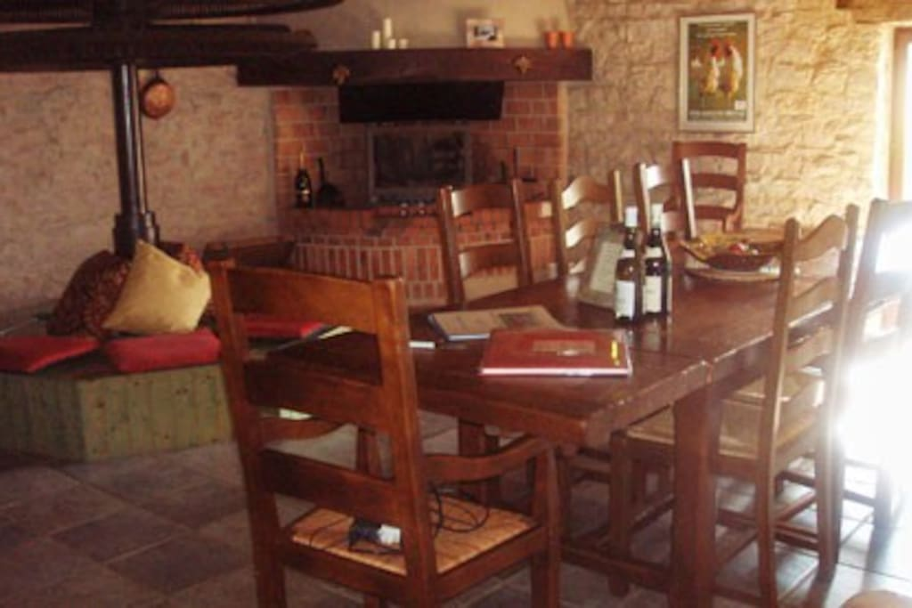 Dining room and with access to kitchen and terrace, with lounge area in front of fireplace
