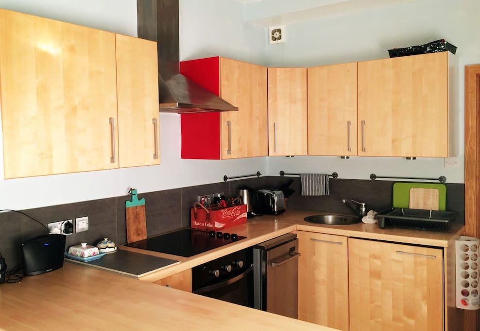 New kitchen with washing machine, dishwasher, fridge & freezer.