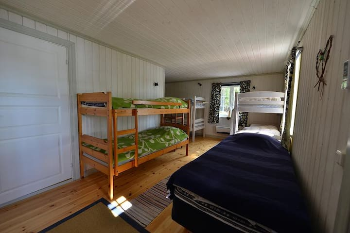 Some of the beds, closest to the bathroom door. The closest bunk bed is now a single bed.