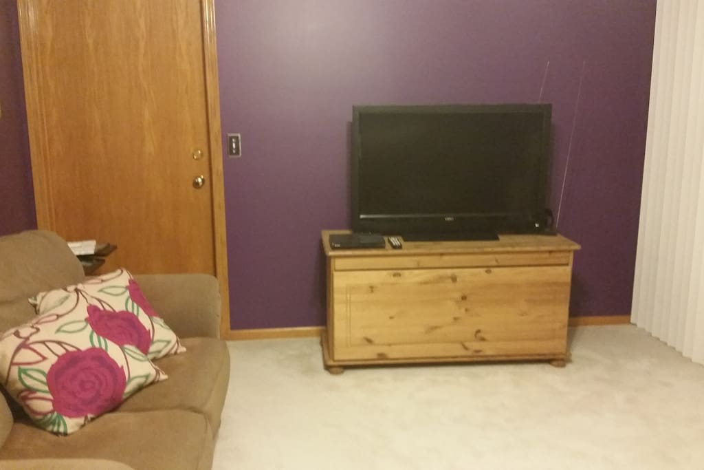 Love seat in living room, 42'in tv and dvd player