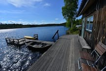 Outside the sauna is the bridge with the boat, canoe and the ladder into the water!