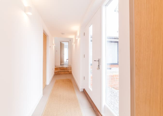 Connecting corridor to the house and seperate entrance
