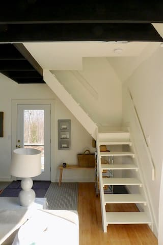 Stairs to the second floor/bedroom.